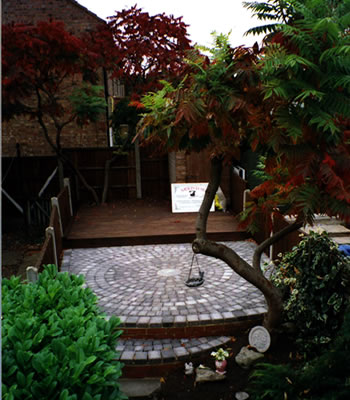 a finished garden patio with block paving